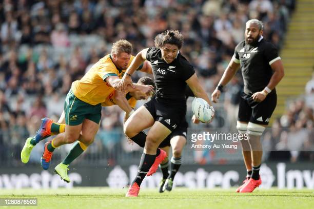 Caleb Clarke of the All Blacks beats the tackle from James Slipper and Nic White of the Wallabies during the Bledisloe Cup match between the New...