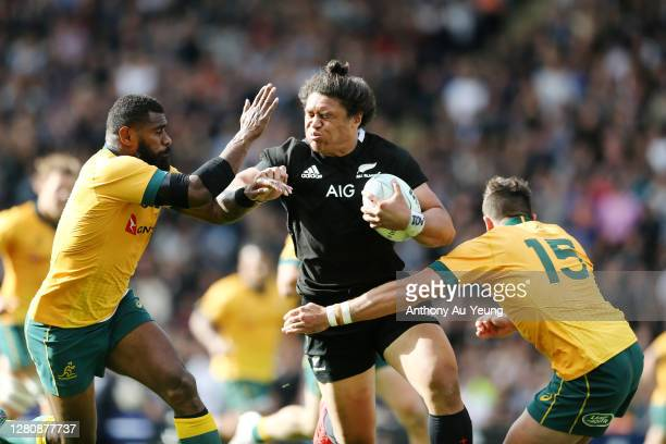 Caleb Clarke of the All Blacks looks to fend against Marika Koroibete and Tom Banks of the Wallabies during the Bledisloe Cup match between the New...