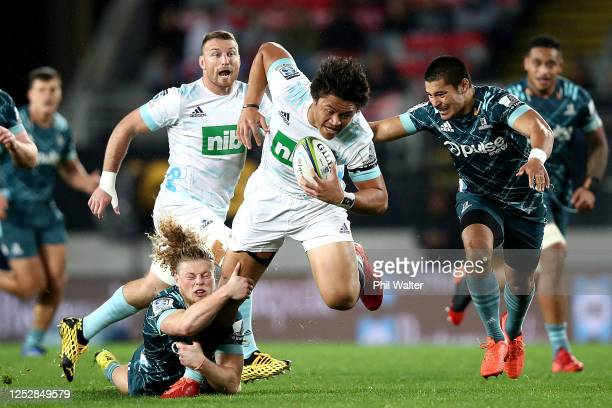 Caleb Clarke of the Blues is tackled by Scott Gregory of the Highlanders during the round 3 Super Rugby Aotearoa match between the Blues and the...