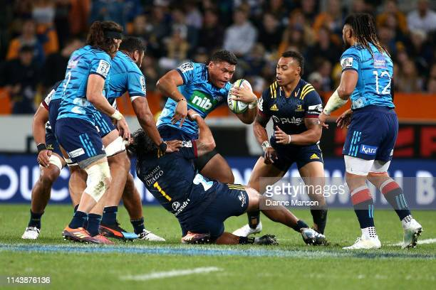 Caleb Clarke of the Blues is tackled during the round 10 Super Rugby match between the Highlanders and the Blues at Forsyth Barr Stadium on April 20...