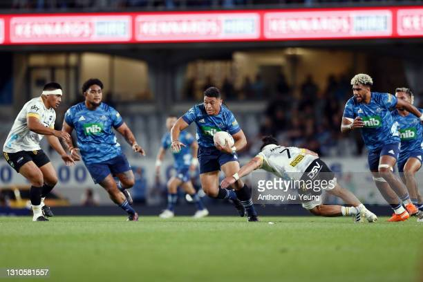 Caleb Clarke of the Blues makes a run against Du'Plessis Kirifi of the Hurricanes during the round 6 Super Rugby Aotearoa match between the Blues and...