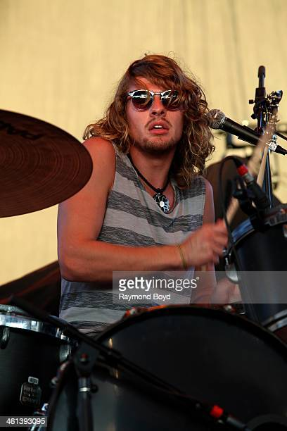 Caleb Crosby from Honey Grove Texas rock band Tyler Bryant The Shakedown performs on the BMO Harris Bank Stage at the Henry W Maier Festival Park...