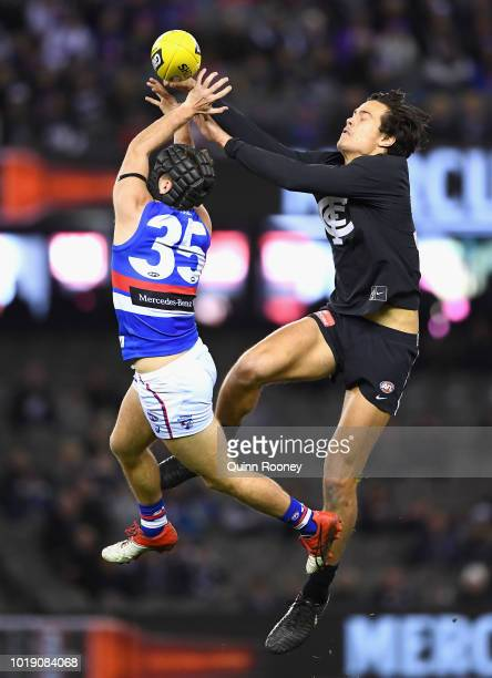 Caleb Daniel of the Bulldogs and Jack Silvagni of the Blues compete for a mark during the round 22 AFL match between the Carlton Blues and the...