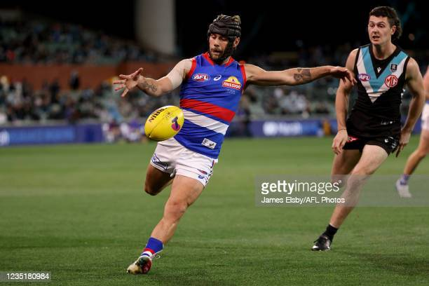 Caleb Daniel of the Bulldogs kicks the ball during the 2021 AFL Second Preliminary Final match between the Port Adelaide Power and the Western...