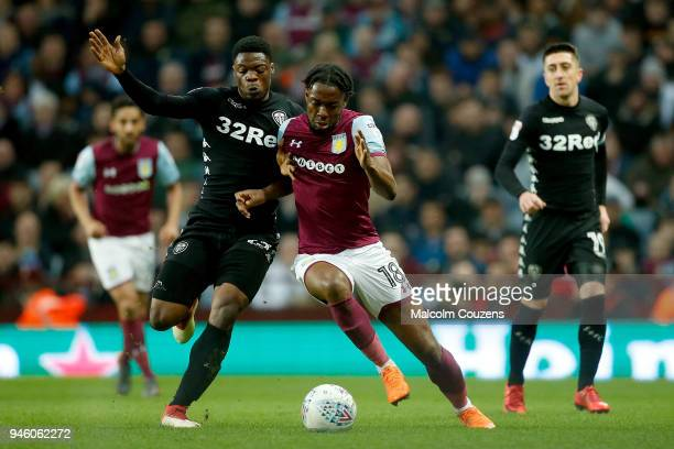 Caleb Ekuban of Leeds United competes with Josh Onomah of Aston Villa during the Sky Bet Championship match between Aston Villa and Leeds United at...