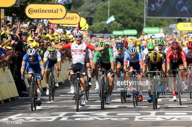 Caleb Ewan of Australia and Lotto Soudal celebrates winning in front of second place Elia Viviani of Italy and Deceuninck-Quick-Step , third place...