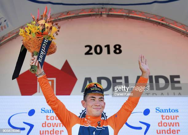 Caleb Ewan of Australia and MitcheltonScott celebrates on the podium after taking the leaders jersey and winning during stage two of the 2018 Tour...