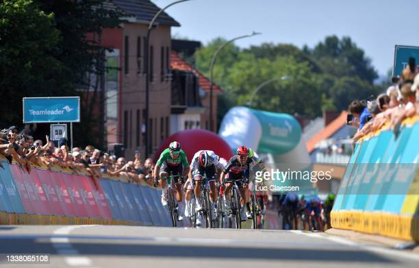 Caleb Ewan of Australia and Team Lotto Soudal sprints to win ahead of Sonny Colbrelli of Italy and Team Bahrain Victorious and Peter Sagan of...