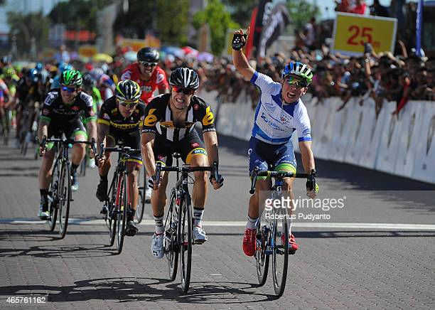 Caleb Ewan of Orica Greenedge and Youcef Reguigui of MTNQhubeka react after cross the finish line at Stage 3 of the 2015 Le Tour de Langkawi from...