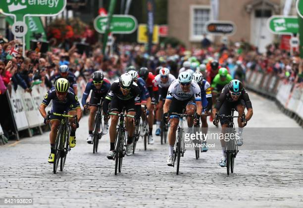 Caleb Ewen of Team Orica Scott wins a sprint finish from Edvald Boasson-Hagen, Alexander Kristoff and Elia Viviani on stage one during the 14th Tour...