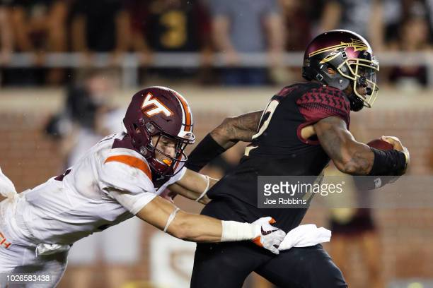Caleb Farley of the Virginia Tech Hokies sacks Deondre Francois of the Florida State Seminoles in the third quarter of the game at Doak Campbell...