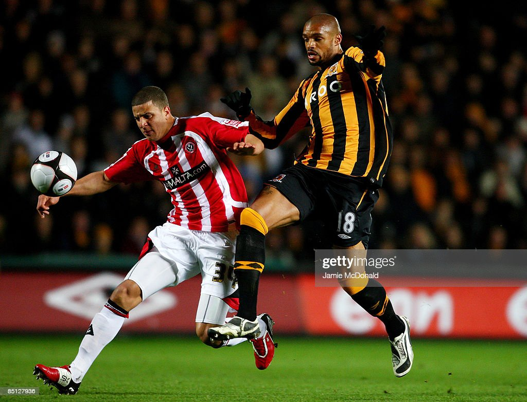 Caleb Folan (R) of Hull battles with Kyle Walker of Sheffield United during the FA Cup sponsored by E.on 5th round replay match between Hull City and Sheffield United at the KC Stadium on February 26, 2009 in Hull, England.
