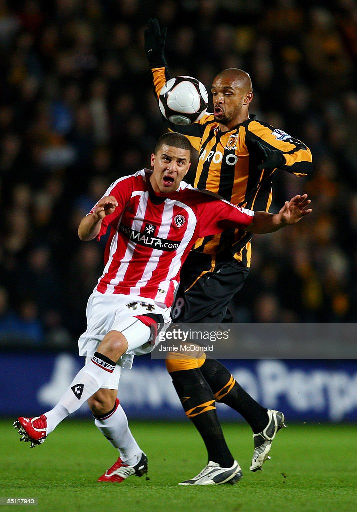 Caleb Folan (R) of Hull battles with Kyle Walker of Sheffield United during the FA Cup sponsored by E.on, 5th round replay match between Hull City and Sheffield United at the KC Stadium on February 26, 2009 in Hull, England.