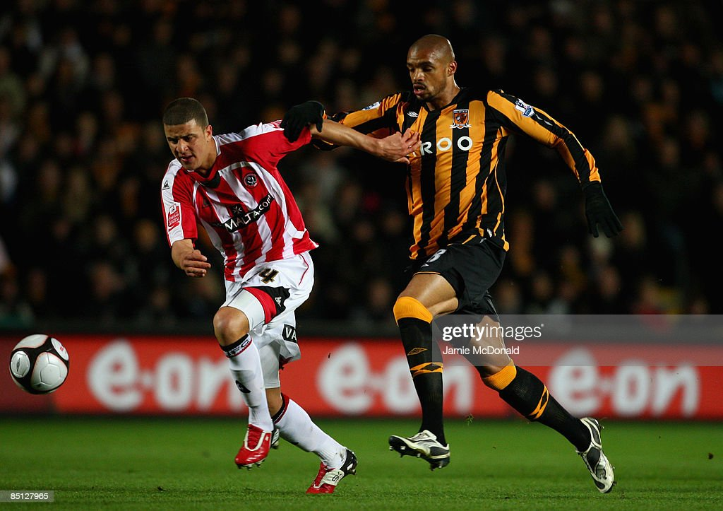 Caleb Folan of Hull battles with Kyle Walker of Sheffield United during the FA Cup sponsored by E.on, 5th round replay match between Hull City and Sheffield United at the KC Stadium on February 26, 2009 in Hull, England.