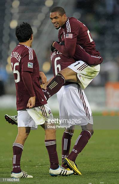 Caleb Folan of the Colorado Rapids is lifted up by Anthony Wallace as Pablo Mastroeni watches as they celebrate Folan's goal in the 81st minute...