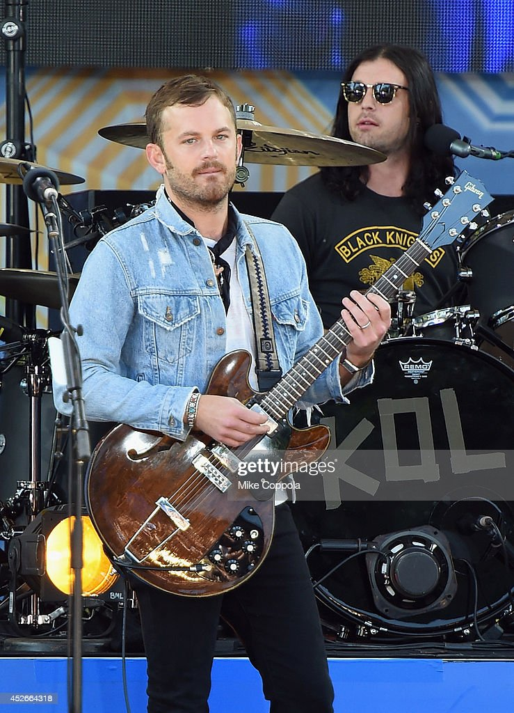 Caleb Followill (L) and Nathan Followill from the band Kings of Leon perform On ABC's 'Good Morning America' at Rumsey Playfield, Central Park on July 25, 2014 in New York City.