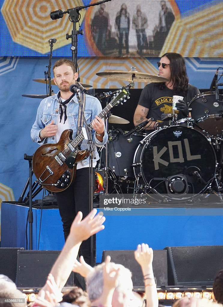 Caleb Followill (L) and Nathan Followill of the band Kings of Leon perform On ABC's 'Good Morning America' at Rumsey Playfield, Central Park on July 25, 2014 in New York City.