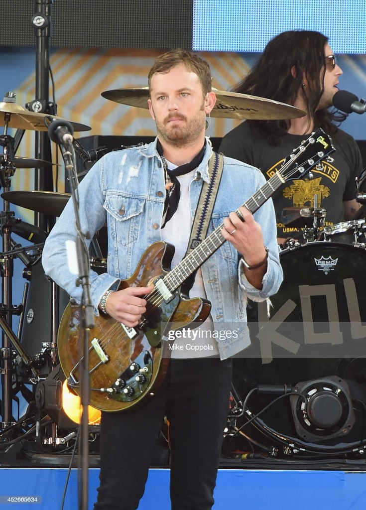 Caleb Followill (L) of the band Kings of Leon performs On ABC's 'Good Morning America' at Rumsey Playfield, Central Park on July 25, 2014 in New York City.
