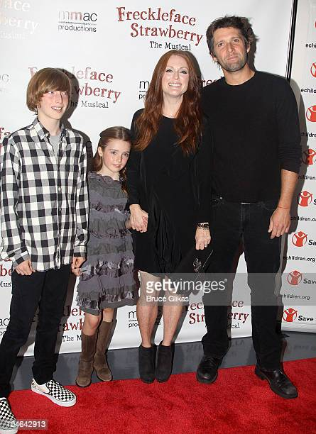 Caleb Freundlich Liv Freundlich mother Julianne Moore and husband Bart Freundlich attend the opening night of 'Freckleface Strawberry The Musical' at...