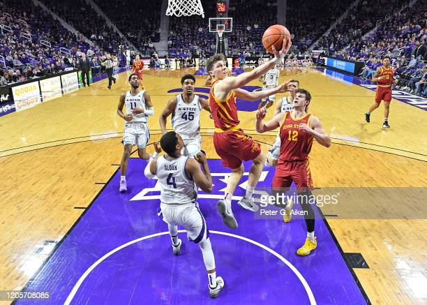 Caleb Grill of the Iowa State Cyclones drives in for a lay up against David Sloan of the Kansas State Wildcats during the second half at Bramlage...