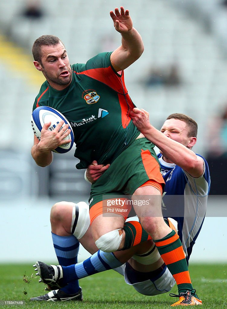 Caleb Hall of Pakuranga is tackled by Sean Brookman of University during the Gallaher Shield Final match between Pakuranga and University at Eden Park on August 3, 2013 in Auckland, New Zealand.