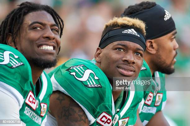 Caleb Holley l} and Duron Carter of the Saskatchewan Roughriders on the sideline during the game between the Toronto Argonauts and Saskatchewan...