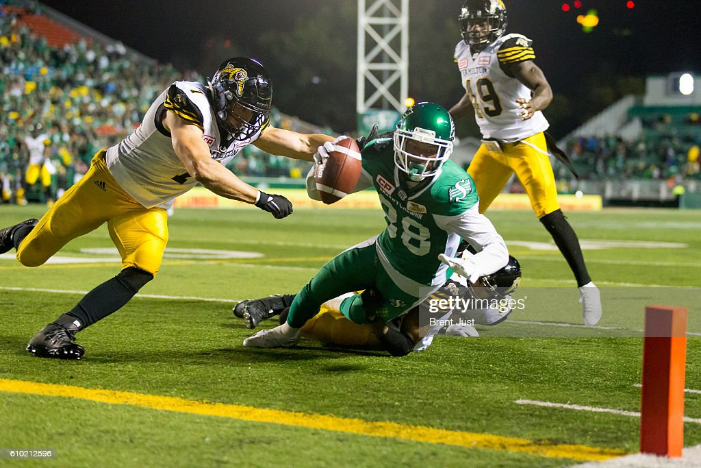 Caleb Holley #88 of the Saskatchewan Roughriders reaches for the goal after making a catch in first half action of the game between the Hamilton Tiger-Cats and Saskatchewan Roughriders at Mosaic Stadium on September 24, 2016 in Regina, Canada.