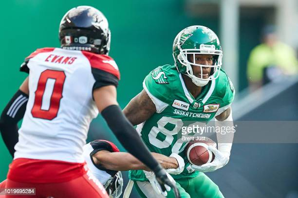 Caleb Holley of the Saskatchewan Roughriders runs with the ball after a catch in the game between the Calgary Stampeders and Saskatchewan Roughriders...