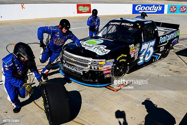 Caleb Holman driver of the Food Country USA Lopez Wealth Mgmt Morning Fresh Farms Chevrolet pits during the NASCAR Camping World Truck Series Kroger...
