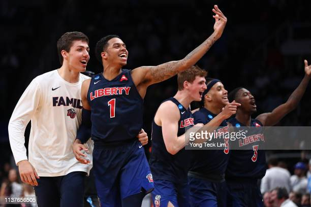 Caleb Homesley and the Liberty Flames celebrate their 8076 win over the Mississippi State Bulldogs during their game in the First Round of the NCAA...