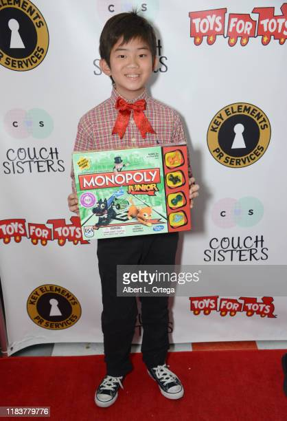 Caleb Jean attends The Couch Sisters 1st Annual Toys For Tots Toy Drive held onNovember 20 2019 in Glendale California