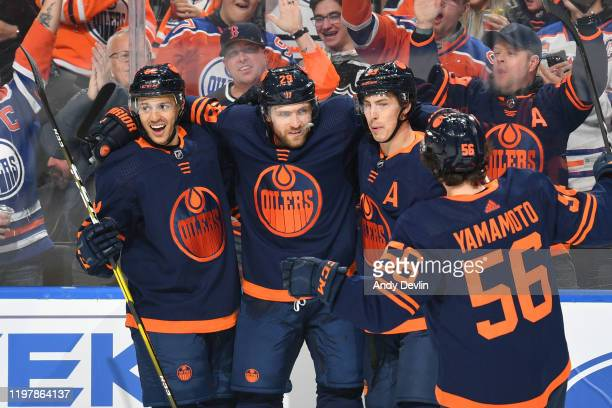 Caleb Jones, Leon Draisaitl, Ryan Nugent-Hopkins and Kailer Yamamoto of the Edmonton Oilers celebrate after a goal during the game against the St....