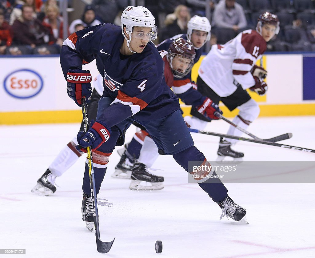 Caleb Jones #4 Team USA skates with the puck against Team Latvia during a preliminary game at the 2017 IIHF World Junior Hockey Championship at the Air Canada Centre on December 26, 2016 in Toronto, Ontario, Canada. USA defeated Latvia 6-1.