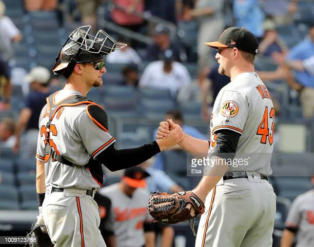 Caleb Joseph ad Mike Wright Jr #43 of the Baltimore Orioles celebrate the 75 win over the New York Yankees at Yankee Stadium on August 1 2018 in the...