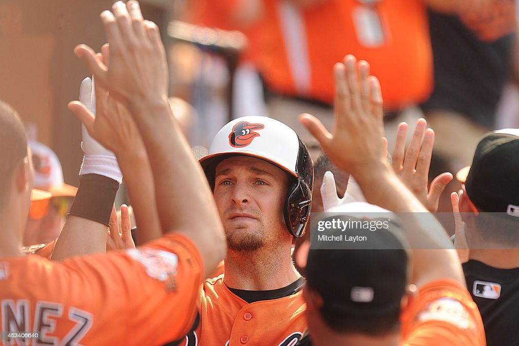 Caleb Joseph #36 of the Baltimore Orioles celebrates hitting a two-run home run in the second inning during a baseball game against the St. Louis Cardinals on August 9, 2014 at Oriole Park at Camden Yards in Baltimore, Maryland. The Orioles won 10-3.