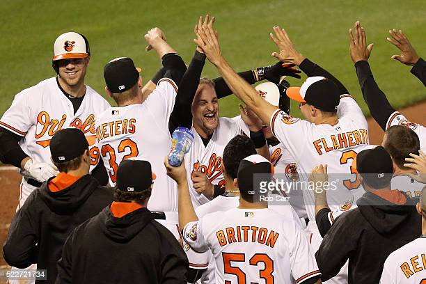Caleb Joseph of the Baltimore Orioles celebrates with teammates after scoring the winning run on a passed ball in the tenth inning against the...