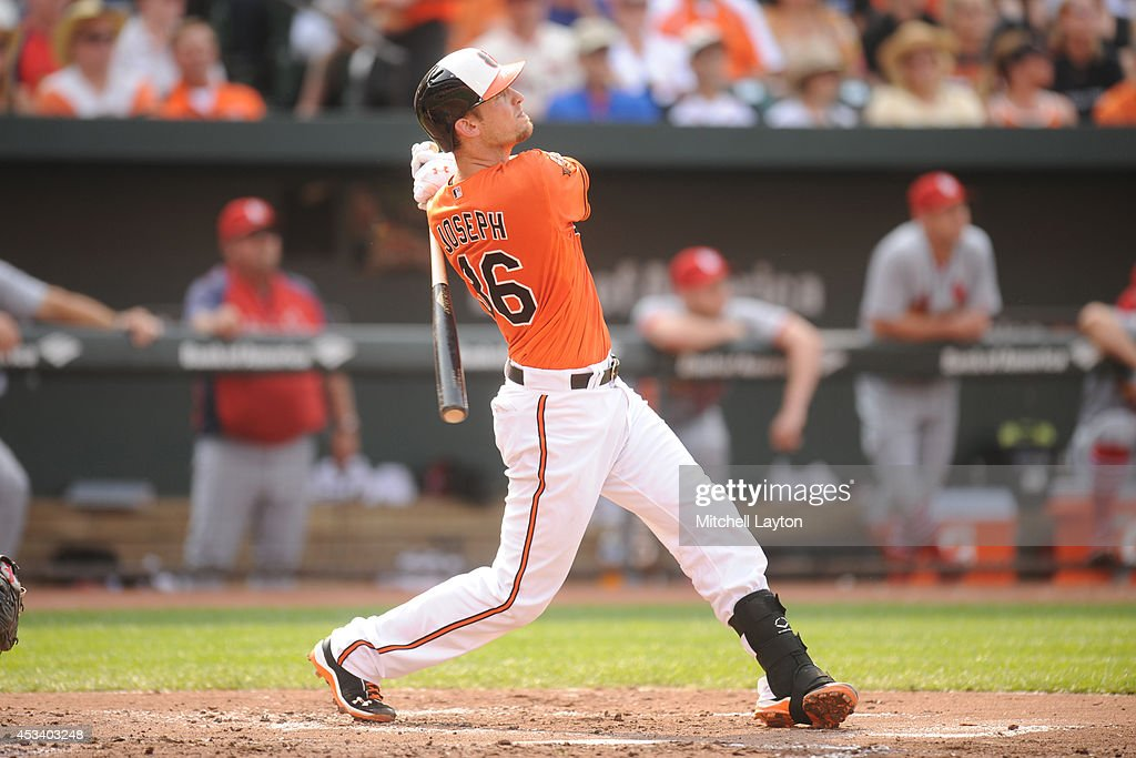 Caleb Joseph #36 of the Baltimore Orioles hits a two-run home run in the second inning during a baseball game against the St. Louis Cardinals on August 9, 2014 at Oriole Park at Camden Yards in Baltimore, Maryland.