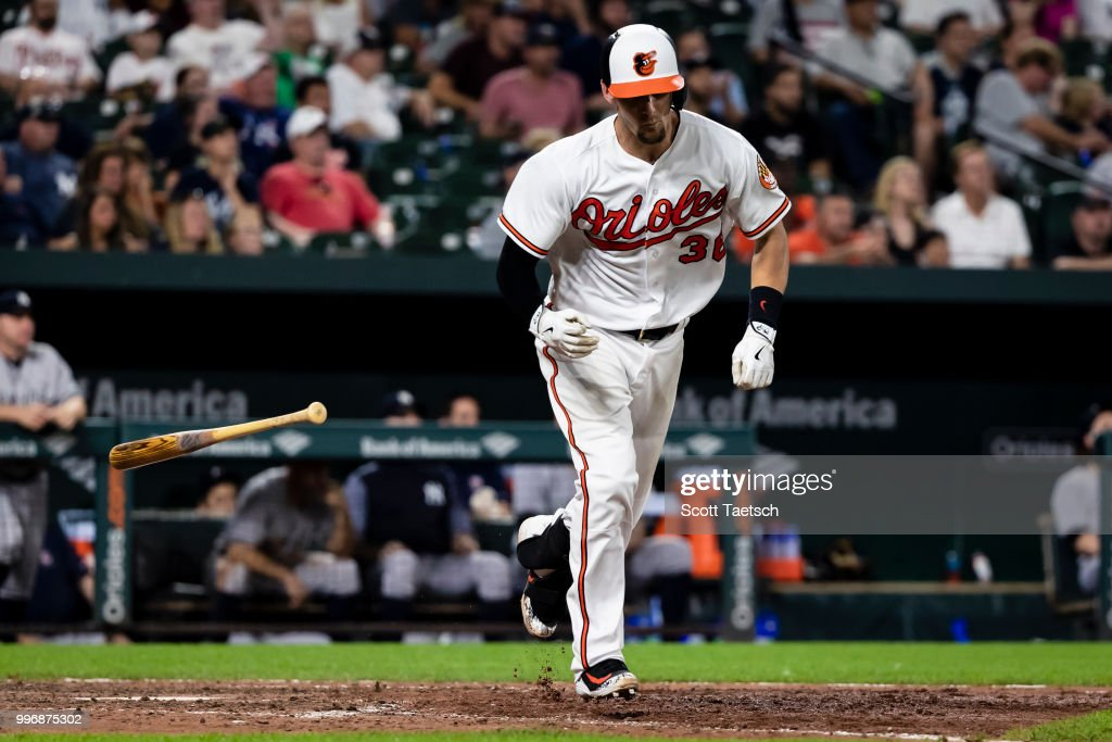 Caleb Joseph #36 of the Baltimore Orioles singles against the New York Yankees during the eighth inning at Oriole Park at Camden Yards on July 11, 2018 in Baltimore, Maryland.