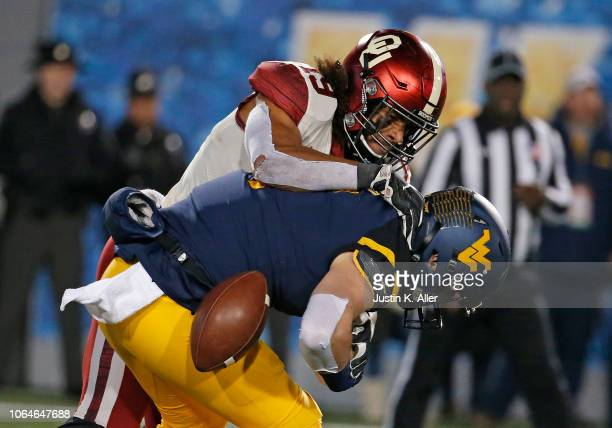 Caleb Kelly of the Oklahoma Sooners forces Will Grier of the West Virginia Mountaineers to fumble the football on November 23 2018 at Mountaineer...