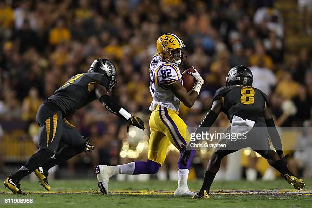 Caleb Lewis of the LSU Tigers is tackled by Thomas Wilson of the Missouri Tigers at Tiger Stadium on October 1, 2016 in Baton Rouge, Louisiana.
