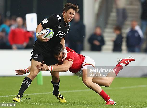 Caleb Makene of New Zealand is tackled by Jared Rosser of Wales during the World Rugby U20 Championship match between New Zealand and Wales at AJ...
