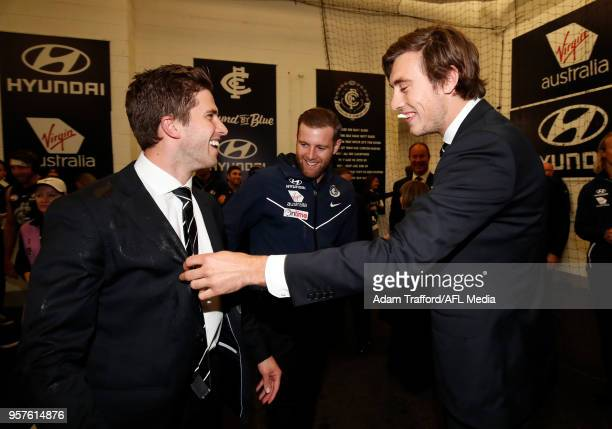 Caleb Marchbank and Sam Docherty of the Blues point out to Injured captain Marc Murphy of the Blues the gatorade on his suit from hugging players...