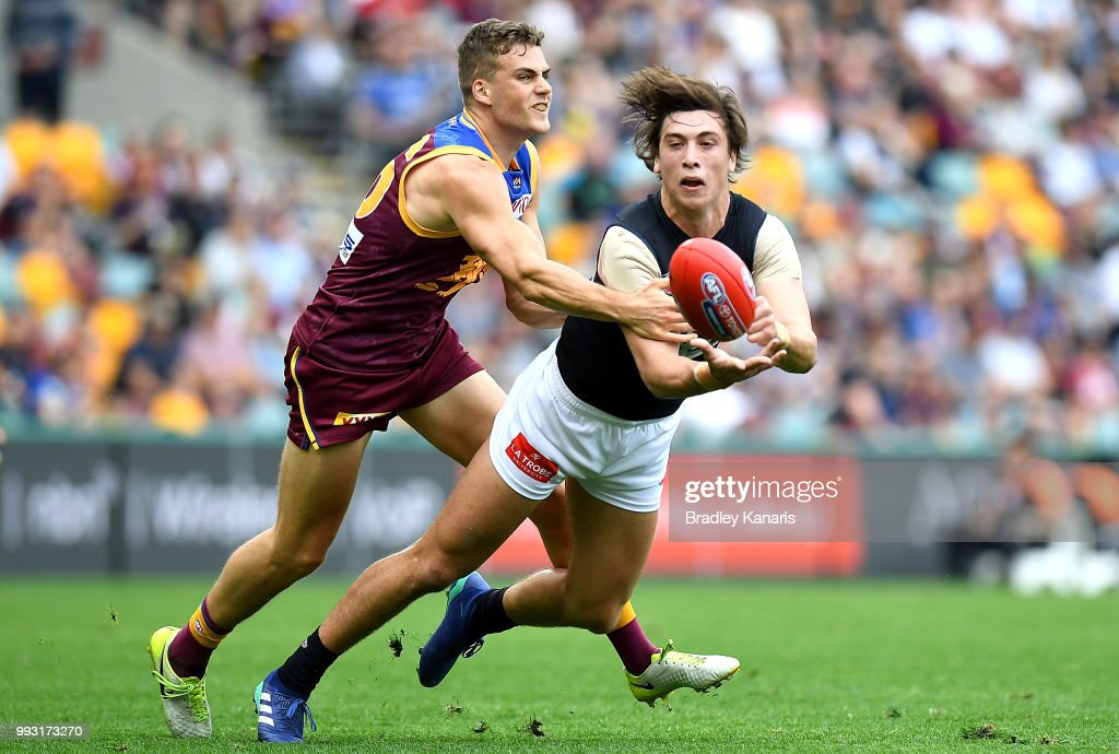 Caleb Marchbank of Carlton gets a handball away during the round 16 AFL match between the Brisbane Lions and the Carlton Blues at The Gabba on July 7, 2018 in Brisbane, Australia.