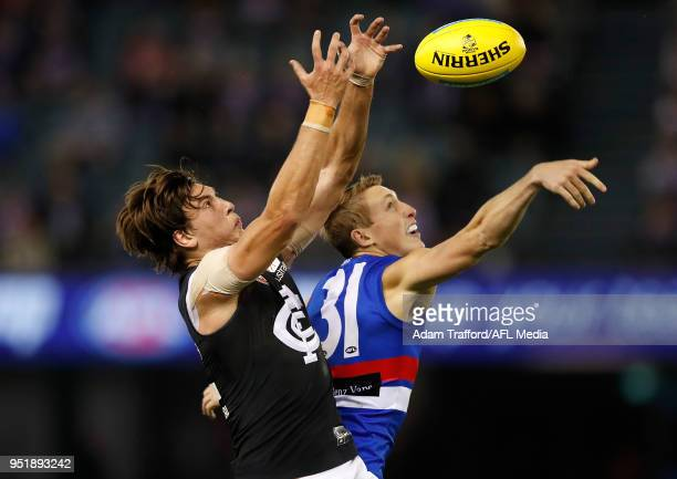Caleb Marchbank of the Blues and Bailey Dale of the Bulldogs compete for the ball during the 2018 AFL round six match between the Western Bulldogs...