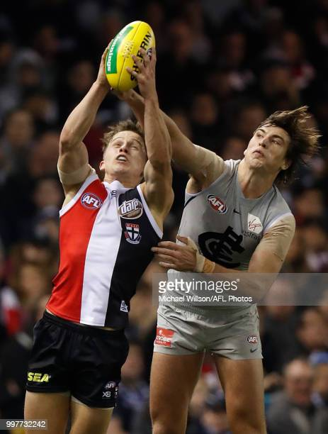 Caleb Marchbank of the Blues and Jack Billings of the Saints compete for the ball during the 2018 AFL round 17 match between the St Kilda Saints and...