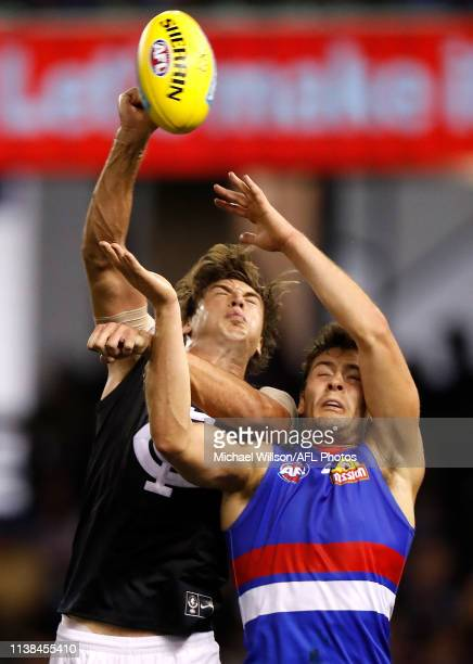 Caleb Marchbank of the Blues and Josh Dunkley of the Bulldogs compete for the ball during the 2019 AFL round 05 match between the Western Bulldogs...