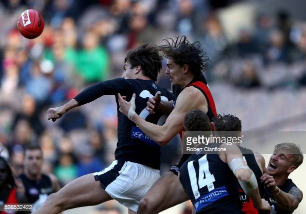 Caleb Marchbank of the Blues is challenged by Joe Daniher of the Bombers during the round 20 AFL match between the Essendon Bombers and the Carlton...