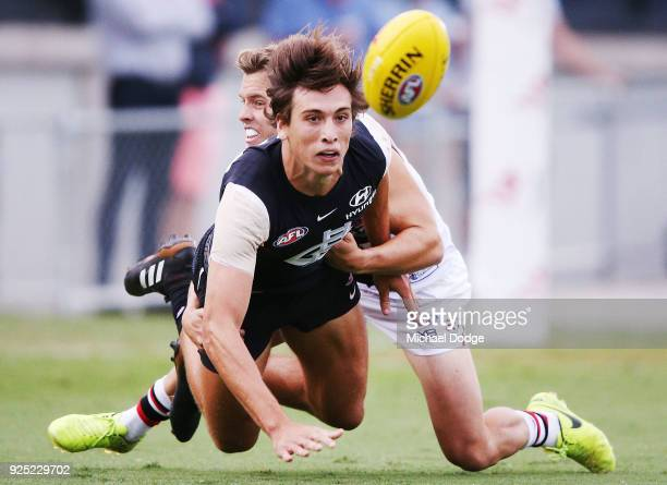 Caleb Marchbank of the Blues is tackled by Jack Lonie of the Saints during the JLT Community Series AFL match between the Carlton Blues and the St...