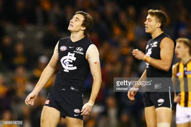 Caleb Marchbank of the Blues kicks the ball but misses during the round 18 AFL match between the Carlton Blues and the Hawthorn Hawks at Etihad...