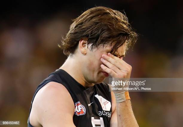 Caleb Marchbank of the Blues looks dejected after a loss during the 2018 AFL round 01 match between the Richmond Tigers and the Carlton Blues at the...